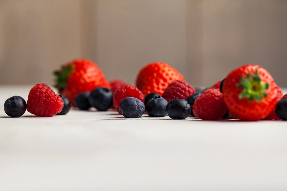 Fresh berries in close up on wooden table